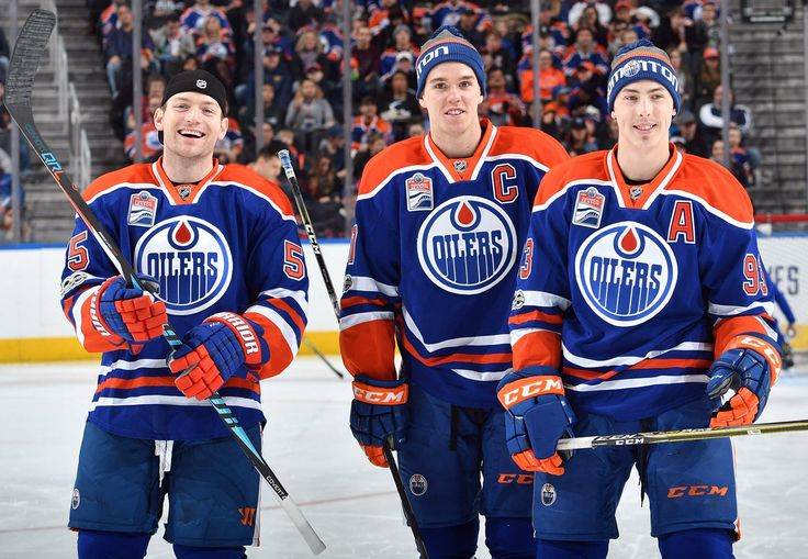Mark Letestu, Connor McDavid, and Ryan Nugent-Hopkins