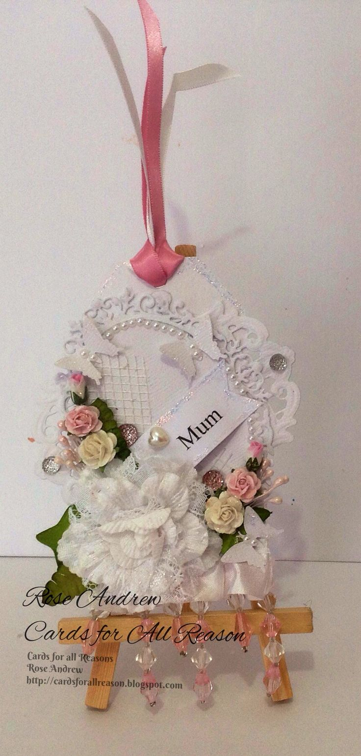 White On White Tag with lace, fabric flower, paper roses butterflies and pearls. Requested by a customer .