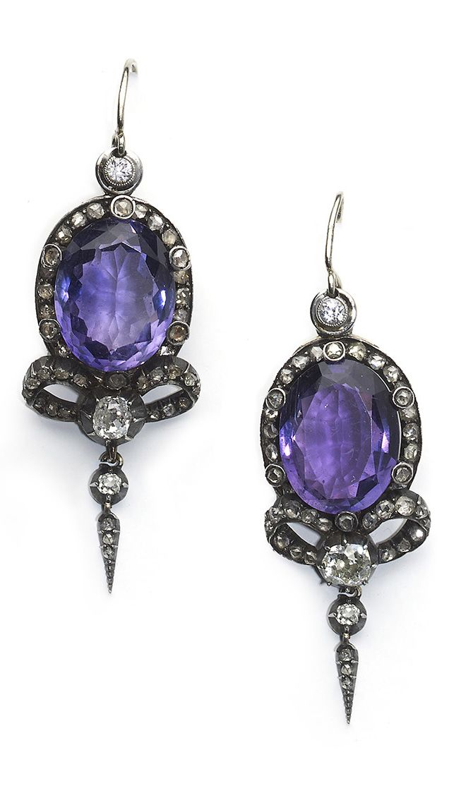 VICTORIAN AMETHYST & DIAMOND EARRINGS. A pair of Victorian amethyst and diamond earrings, each earring centering an oval-cut amethyst within a diamond border and bow motif with an old-cut diamond to the centre and three further old-cut diamonds. Silver and gold mounted.
