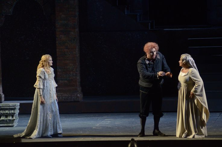 Rigoletto (Devid Cecconi) entrusting the daughter Gilda (Ekaterina Bakanova) to the 	governess Giovanna (Silvia Pasini).