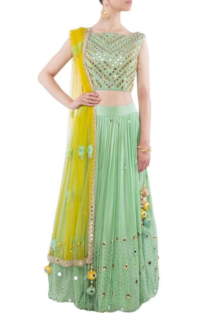 Sea green mirror work lehenga by Kanika Chawla. Shop now…