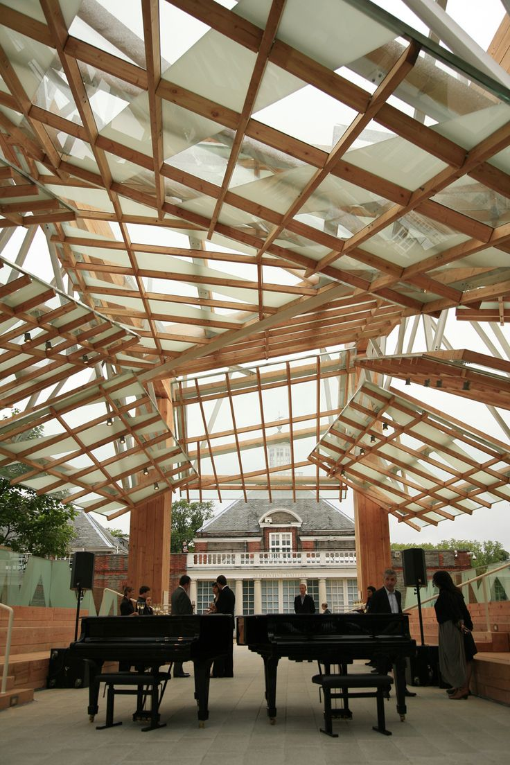 Frank Gehry's 2008 Serpentine Gallery Pavilion consisted of four wood-clad steel columns, which supported a series of large timber planks and beams.