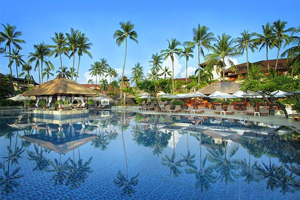 Sitting in lush tropical gardens on a beautiful stretch of Nusa Dua's white sandy beach, the Nusa Dua Beach Hotel & Spa is a honeymoon resort designed to resemble a Balinese palace