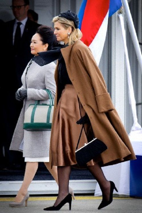 Queen Maxima of the Netherlands welcomes Peng Liyuan, wife of Chinese president at the airport of Schiphol, Amsterdam, The Netherlands, 22.03.2014.