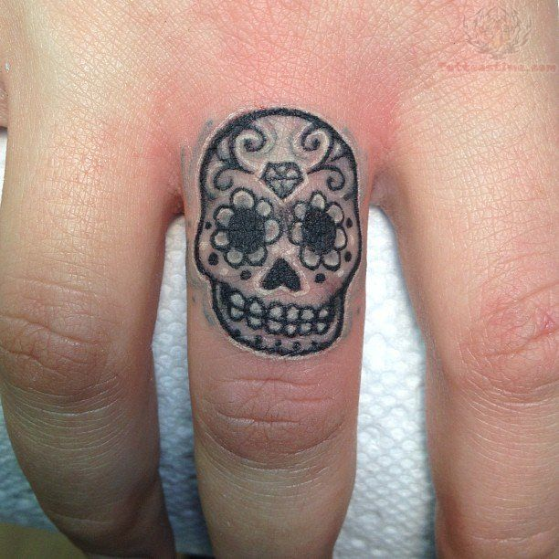 Sugar skull finger tattoo for my mom. On both her thumbs. One in black ink and the other in white ink. Evil and good!!