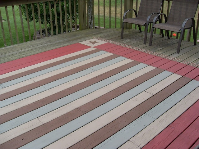 faux rug painted on deck - I would use different colors but looks easy enough.