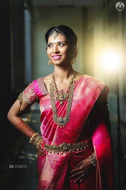South Indian bride. Temple jewelry. Jhumkis.Pink silk kanchipuram sari.Braid with fresh flowers. Tamil bride. Telugu bride. Kannada bride. Hindu bride. Malayalee bride.