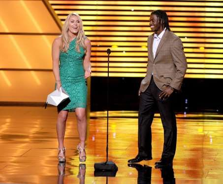 Professional skiier Lindsay Vonn (L) and NFL player Robert Griffin III of the Washington Redskins sp... - Kevin Winter/Getty Images