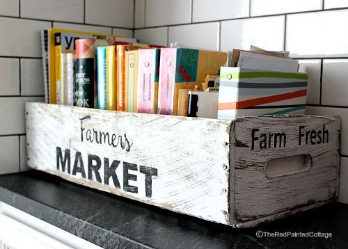 Kitchen decorating tips for bookworms: Keep your books in a rustic crate to add a touch of country charm.