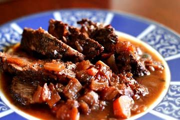 Italian pot roast recipe. Rump or chuck beef roast, first browned in olive oil, then slow cooked in a sofritto base of carrots, celery, and onion, with Italian plum tomatoes and red wine. ~ SimplyRecipes.com