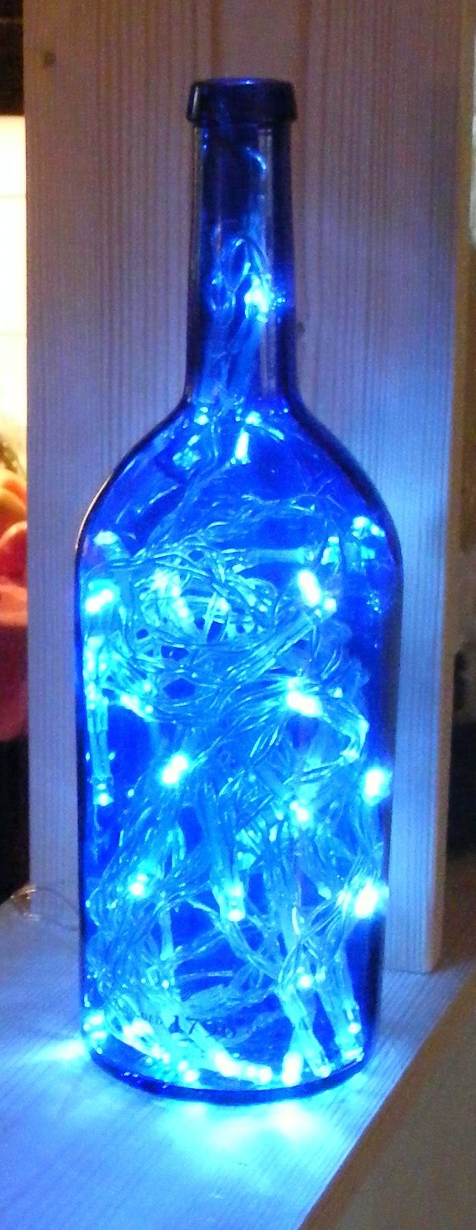 Wine bottles are a plenty!  Know where I can get them....they are just waiting for a new home.  Love this idea.  Thinking of Seahawks lights or other gift ideas.