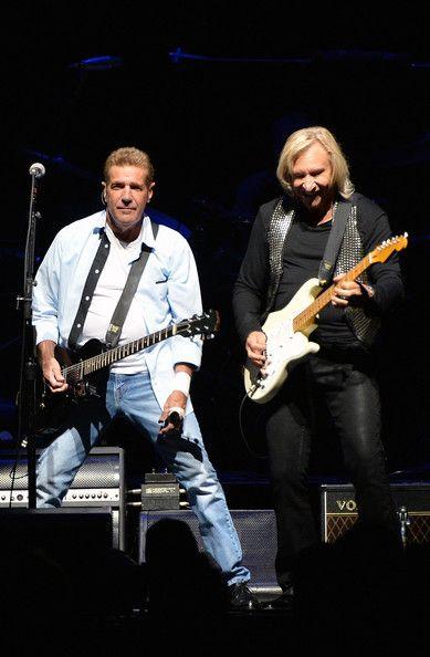 Glen Frey and Joe Walsh of the Eagles perform during 'History of the Eagles Live in Concert' at the Bridgestone Arena on October 16, 2013 in...