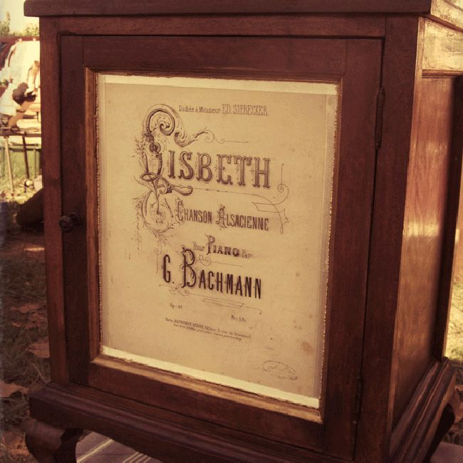renovated oak cabinet with original vintage sheet music