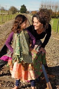 mum and daughter with magic skirts in train rails