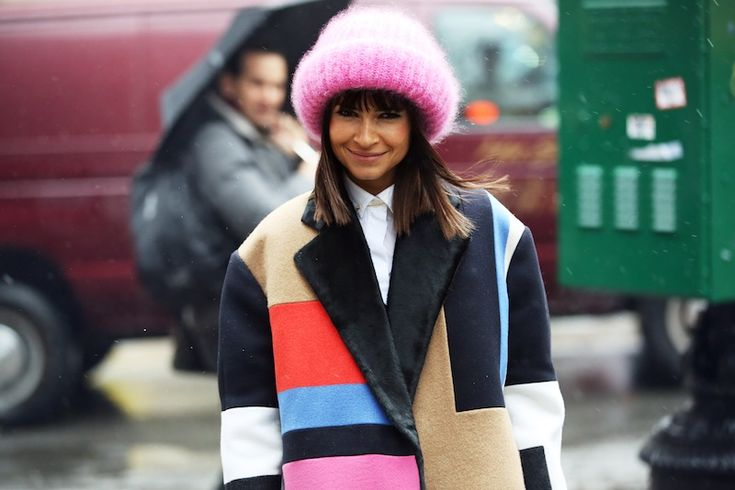 Picture-perfect smile. Loving the contrast on the jacket created by the pastel colors(trend alert) and the black.