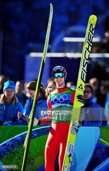 Andreas Wank of Germany smiles as he competes in the men's ski jumping team event on day 11 of the 2010 Vancouver Winter Olympics at Whistler Olympic...