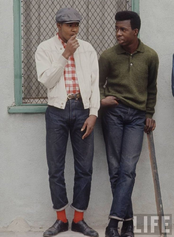 The city's in flames, societal fabric's unravellin', but still these cats look cool. The Dapper Rebels of the Watts Riots, Los Angeles, 1966.