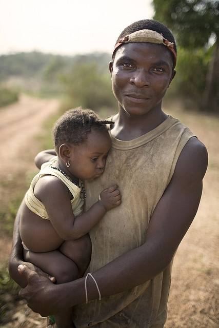 Africa   Father and daughter photographed in a small village (Gbolokai) in Liberia   © Christopher Herwig.