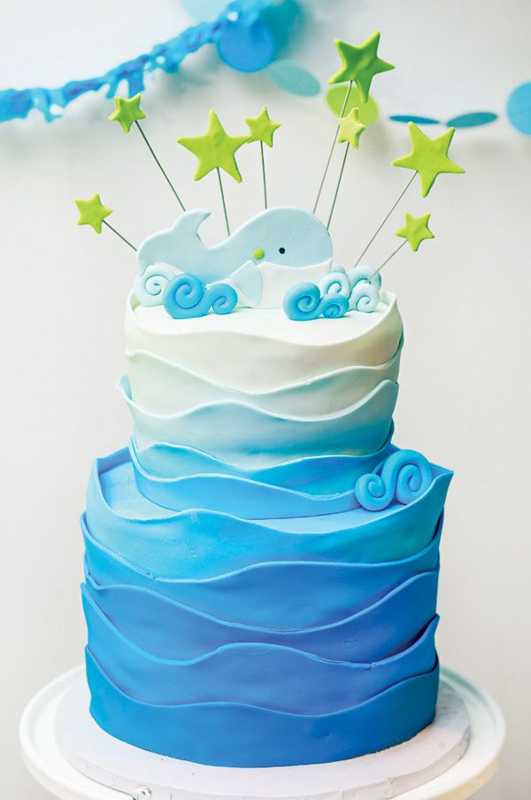 I like the wave design fondant around this - could use for a yacht/ship/pirate themed cake.
