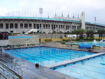 The Los Angeles 1932 Olympic swimming pool had a $30million refurbishment after being abandoned in mid 90s to 2003. Standing next to the LA Coliseum it is now called the LA84 Foundation/John C. Argue Swim Stadium and is now a public recreation pool.