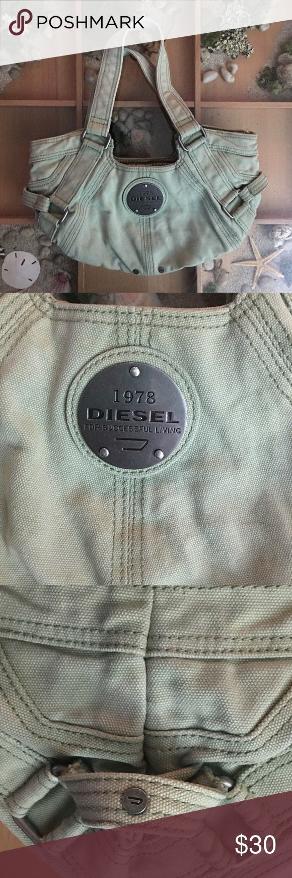 Diesel metal logo canvas handbag purse 👜 This is a great bag, a light sage green with metal accent logo and zipper pulls, has been used but I have had it professionally cleaned. You can see the top of the inside is where you can see. Diesel Bags
