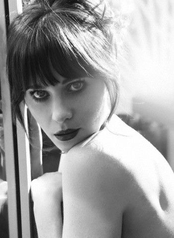 "Zooey Deshanel - singer of ""She and Him"" and actress of ""(500) Days of Summer"""