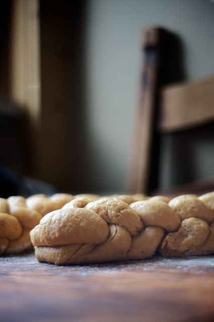 Whole grain sourdough challah rising on the kitchen table.