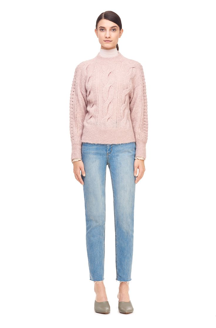 The Plush Cable Drop Shoulder Pullover is knit with lush texture and a chic silhouette.