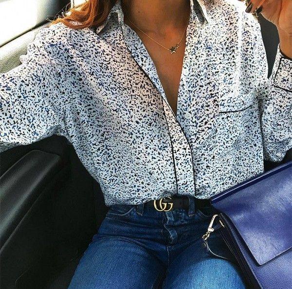 Printed blouse, skinny jeans, and a Gucci belt.