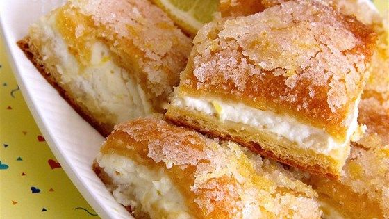 Lemon cream cheese bars are a variation of the traditional lemon bars, made with crescent roll dough and a lemony cream cheese filling.