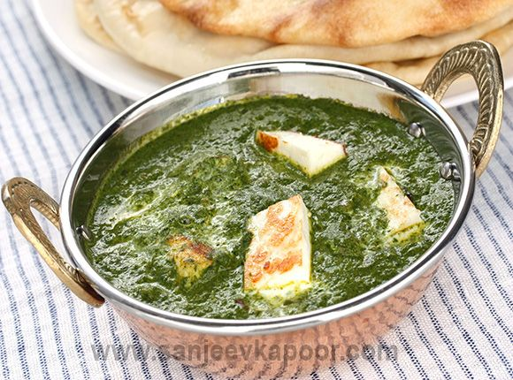 How to make Palak Paneer.-Chunks of cottage cheese simmered in a spiced spinach puree garnished with cream, tastes delicious with rotis.