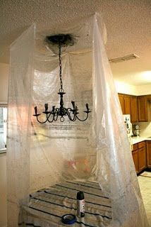 Spray paint chandelier while hanging