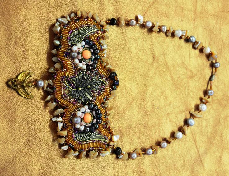 Couture Necklace Natural sea pearls, Thai Buddhist Charmed Pendant, vintage pendant and vintage buttons