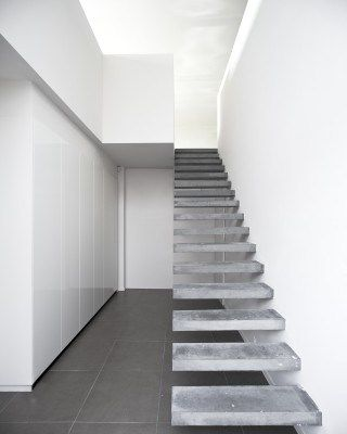concrete floating stairs by theunynck-knockaert architecten - picture by Annick Vernimmen