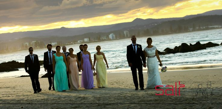 Bridal party with pastel colours and sunset