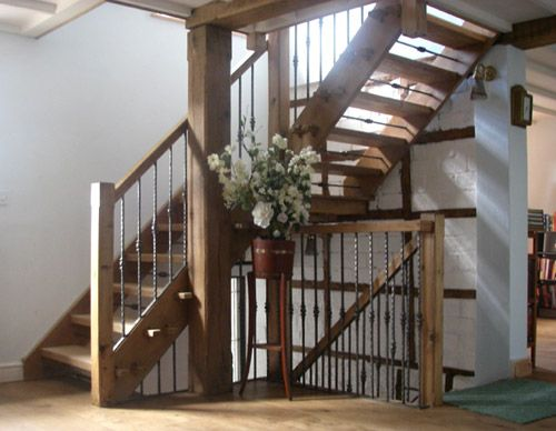 Welsh oak staircases with drop forged wrought ironwork balustrade