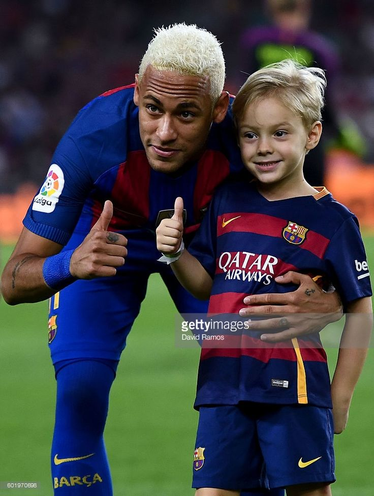 Neymar Jr. of FC Barcelona and his son Davi Lucca give their thumbs up prior to the La Liga match between FC Barcelona and Deportivo Alaves at Camp Nou stadium on September 10, 2016 in Barcelona, Spain.