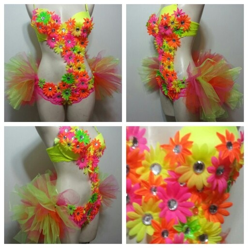 Dollar store flowers and a few jewels. Hot glued onto a swim suit. Burning Man.