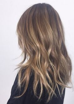 Bronde hair color with hints of lighter blonde highlights. Color by Jimmy Hilton.