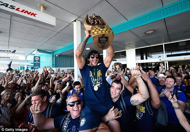 The Cowboys have received an ecstatic greeting by thousands of fans on their return to Townsville airport on Monday
