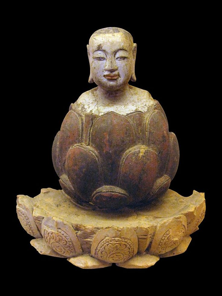 The boy Buddha rising up from lotus. Crimson and gilded wood, Trần-Hồ dynasty, Vietnam, 14th-15th century. Statue for worship. National Museum of Vietnamese History, Hanoi.