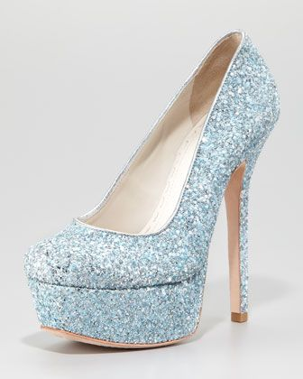 """stunning, glitter-splashed Alice + Olivia pump perfects any look for an evening out.•Glitter upper. •6"""" covered heel and 2"""" platform; 4"""" equiv. •Metallic leather trims low-dipped, leg-lengthening vamp. •Round toe. •Leather lining, padded footbed, and outsole. •""""Larimore"""" is made in Brazil."""