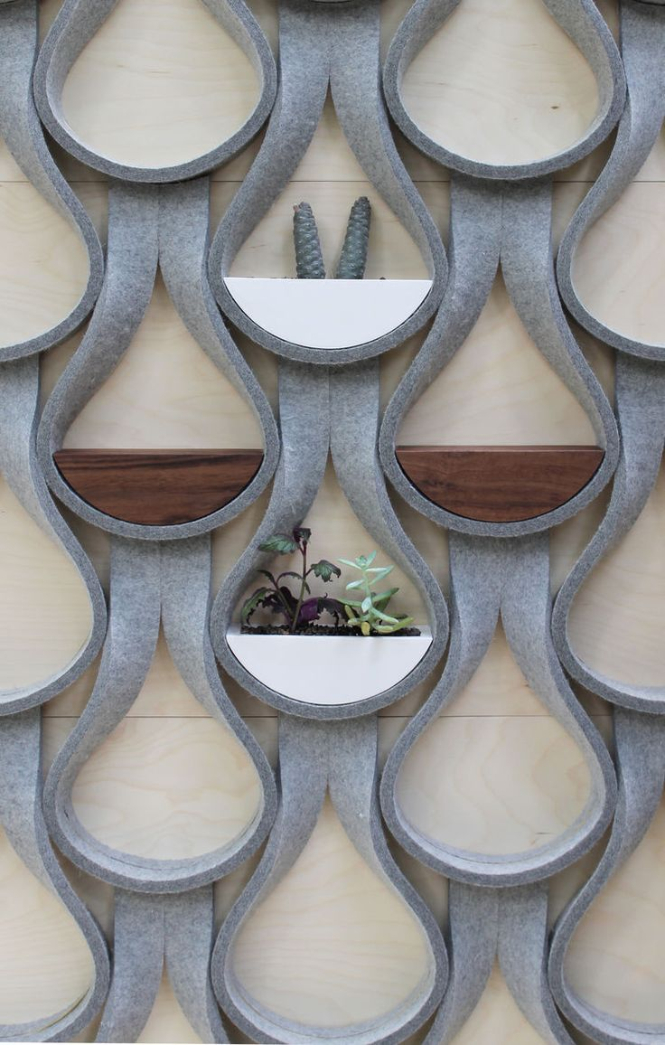Felt Droplet system by Garman Furniture - The Felt Droplet system by Garman Furniture consists of strips of natural wool felt that are capable of supporting a two-inch-deep shelf or planter.