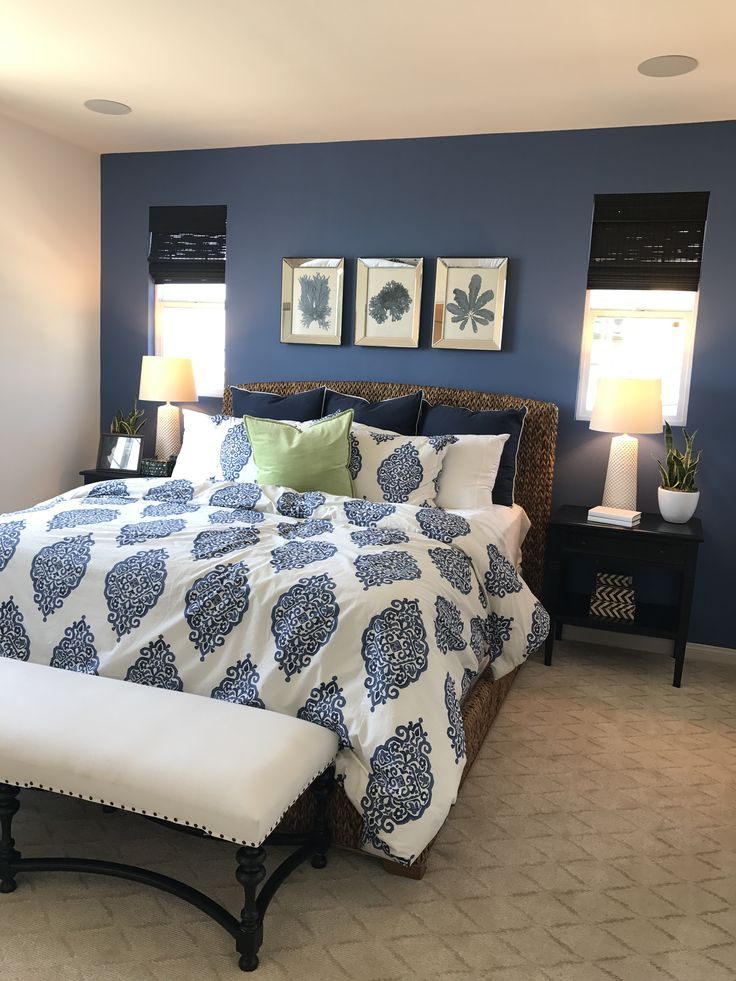 Add life to the room with green plants and finish with a. Dark blue accent wall | Blue master bedroom, Master