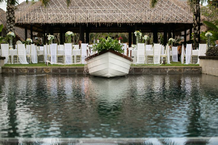 Stage Boat in Infinity Pool with backdrop with Dinner Set Up