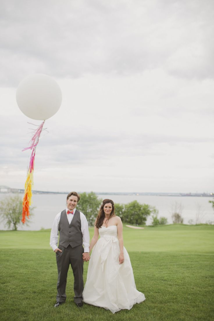 Fringe tassel balloon and bride and groom at bright and colorful pink, orange, yellow and gray weddding at Burlington Golf and Country Club | Planning and Design by www.kjandco.ca | Photography by Elizabeth In Love Read more - http://www.stylemepretty.com/2013/09/04/burlington-ontario-wedding-from-kj-co-beth-ty-in-love/