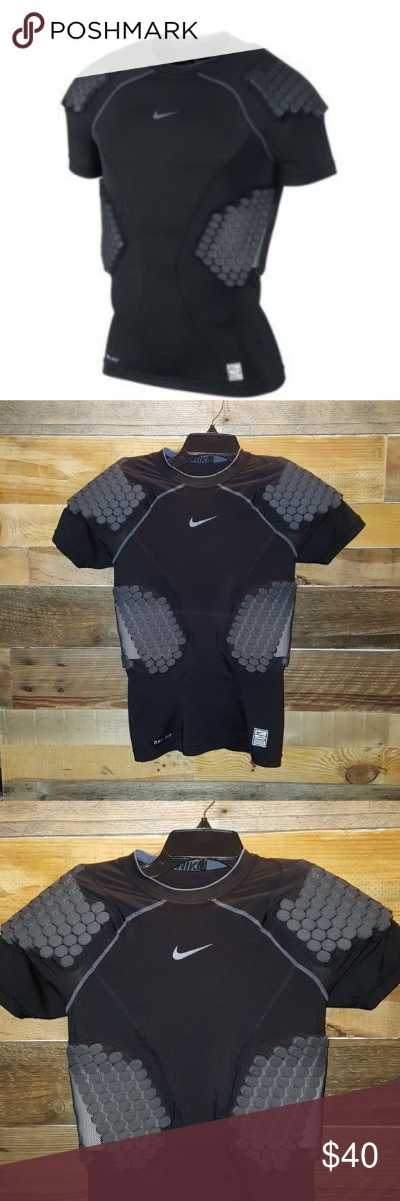 NIKE PRO COMBAT DRI FIT COMPRESSION SHIRT NIKE DRI FIT PADDED COMPRESSION SHIRT SIZE SMALL COLOR BLACK PRO COMBAT PROTECTION PADDED FOOTBALL SHIRT FOR ADDED PROTECTION POLYESTER/SPANDEX EUC-SOME MINOR PILLING ON BACK ALL PADDING STITCHING INTACT  NO TEARS OR HOLES PADDED ON TOPS OF SHOULDERS AND RIBS *NO TRADES NO RETURNS ASK QUESTIONS PLEASE* Nike Other