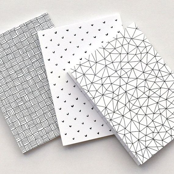Notebook set - Three lined notebooks with a soft cover in different patterns : Hearts, Triangles & Criss Cross. All patterns were hand-drawn using