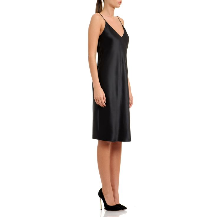 The authenic slip dress is made of pure silk and can be worn back-to-front for a deeper V-cut. The classic black and floor-sweeping length brings timeless appeal. Love it best with golden accessories. Black silk-satin 100% pure silk Fluid textil Wash by hand The model is 176 cm tall and is wearing a size 38. If you need this product made to fit your needs and measures, book an appointment in our studio at i@laurahincu.ro for Private Fashioning.