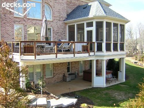 metal railings in enclosed portion allow better view of yard from second floor